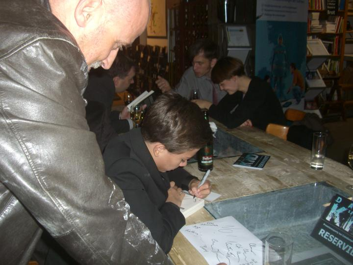 signing autographs at the party after the show